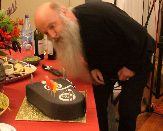 Rex Lawson blowing out the candles on Nancarrow's birthday cake.
