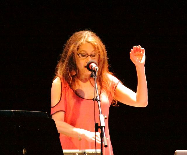 Amy X Neuberg singing at the premiere of Aaron Gervais' 'Work Around the World'.