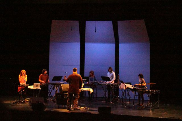 Amy X Neuberg along with the William Winant percussion group playing Aaron Gervais.
