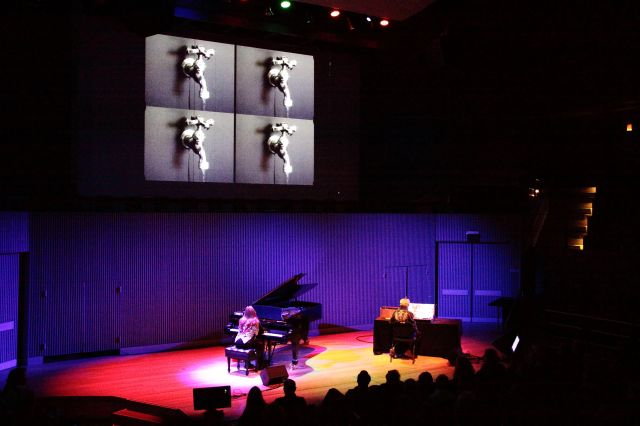 Don Buchla on the Buchla Bos and Nannick Buchla on the piano with film projection performing Drop by Drop (2012) in its American premiere.