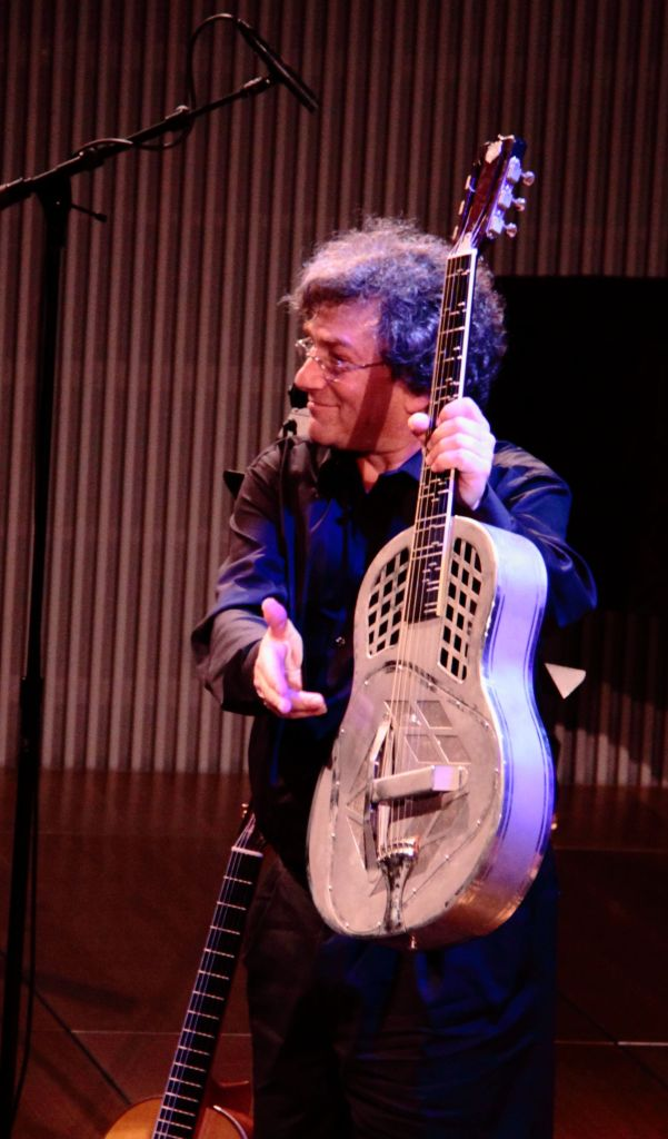 David Tanenbaum holding his National Steel Guitar as he acknowledges the warm applause