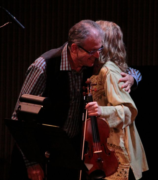 Charles Amirkhanian warmly embraces Kate Stenberg following her performance of his piece.