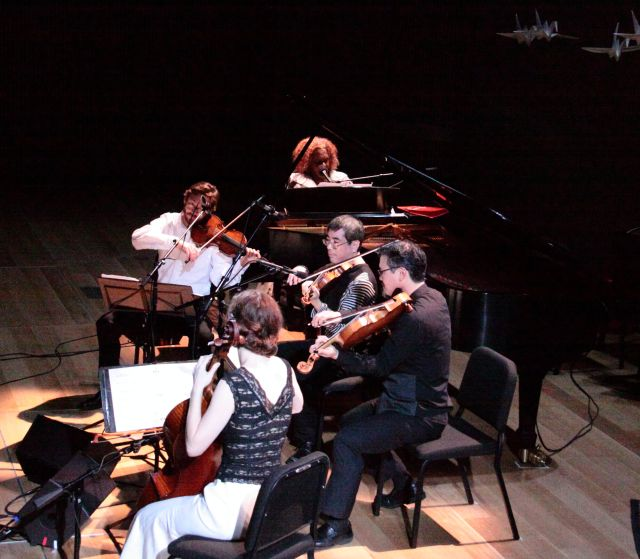 Errollyn Wallen at the piano with the Del Sol String Quartet.