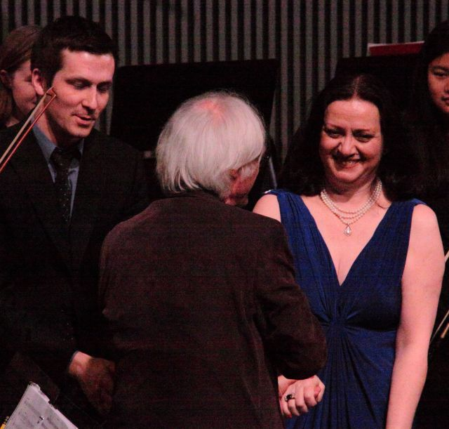 The triumphant soloist and conductor accept the gratitude of the audience, the producers and the composer.