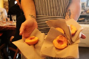 sous chef Cori serving the peach halves that began the dinner.